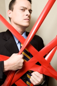 businessman in red tape