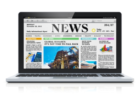 Newspaper on computer screen
